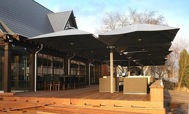 large application of multi mast cantilever outdoor umbrellas