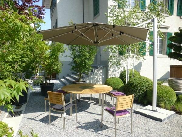 Cantilever umbrella shading courtyard patio