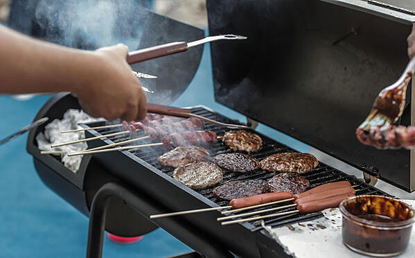 person-grilling-sausage-and-meat-1857732-1